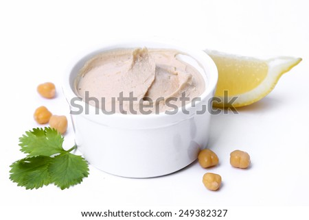 Delicious hummus on a white background - stock photo