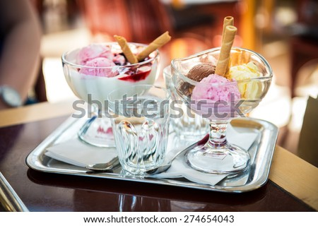 Delicious ice cream balls on table in cafe - stock photo