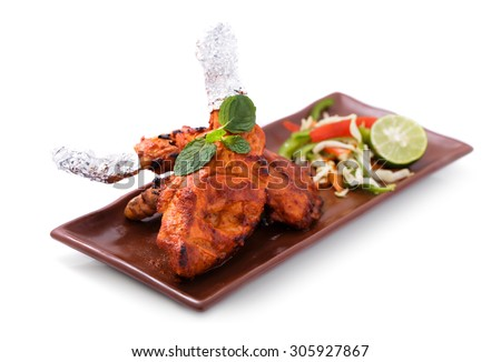 delicious, indian tandoori chicken served with salad isolated on white background - stock photo