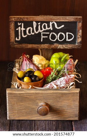 Delicious italian food ingredients in a wooden rustic box. - stock photo