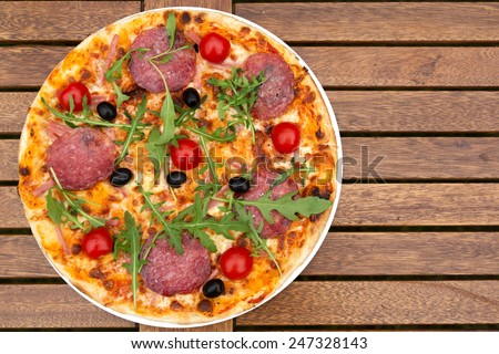 Delicious italian pizza served on wooden table closeup - stock photo
