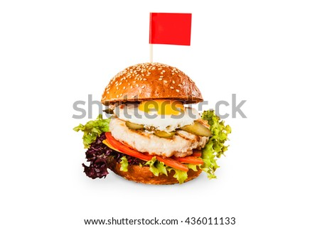 Delicious juicy burger with an egg on white background with a red flag - stock photo