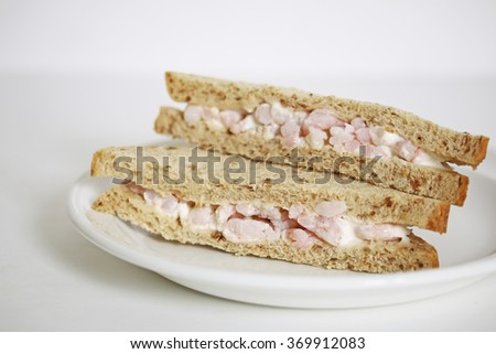 Delicious king prawn sandwich on malted bread and mayonnaise  - stock photo