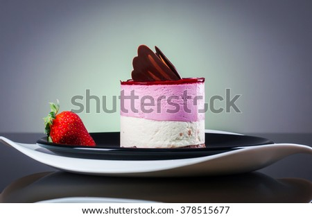 Delicious layer cake with strawberry on a plate - stock photo