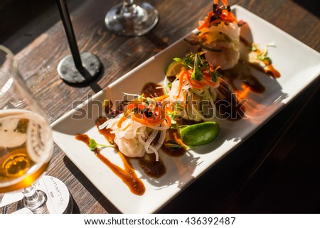 Delicious looking plate of scallop appetizer at a restaurant - stock photo