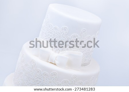 Delicious luxury ping wedding or birthday cake with golden decoration - stock photo