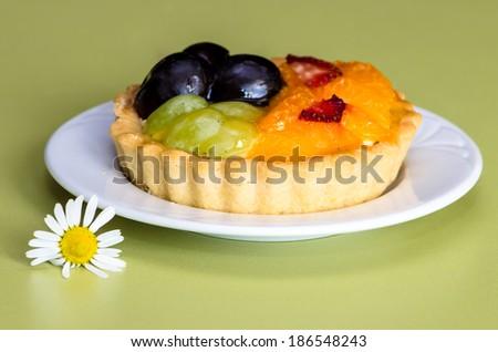 delicious mandarin, strawberry and grape cake image - stock photo