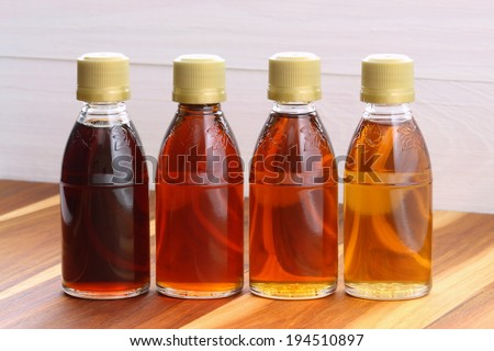 delicious maple syrup made in vermont and canada great over almost any food including the world famous pancakes, waffles and also lots of baked goods.  - stock photo