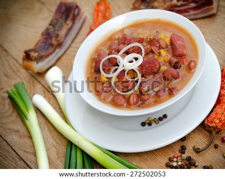 Delicious meal - beans with smoked meat  - stock photo