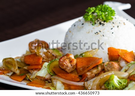 delicious meal with grilled chicken and vegetables prepared and presented restaurant style with fresh ingredients - stock photo