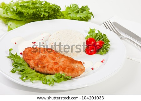 Delicious meat with mixed leaf salad an rice ready to eat on white background - stock photo