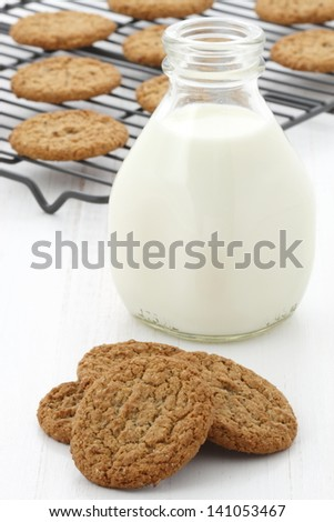 Delicious milk and oatmeal cookies, flavorful dessert that everyone will enjoy and love. - stock photo