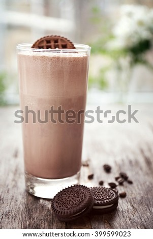 Delicious milk shake cocktail on rustic wooden table, close up - stock photo