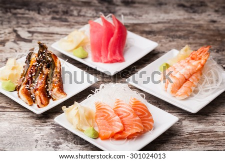 delicious mixed sashimi on a black plate - stock photo