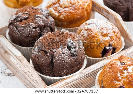 delicious muffins on a wooden tray, closeup - stock photo