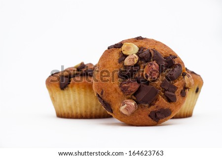 Delicious muffins with chocolate and hazelnut - stock photo