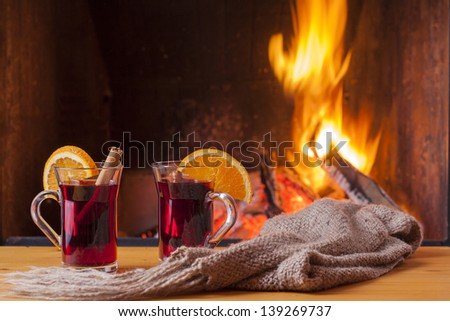 delicious mulled wine at romantic fireplace - stock photo