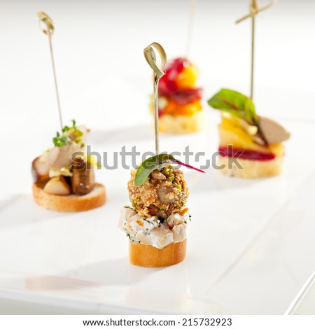 Delicious Mushrooms Canapes on White Dish - stock photo
