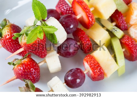 Delicious natural grape skewers strawberries kiwi banana - stock photo