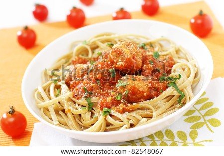 Delicious noodles with tomato and chicken meat - stock photo