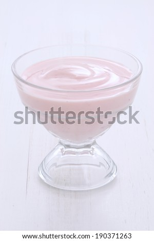 Delicious, nutritious and healthy fresh strawberry yogurt on vintage wood. - stock photo