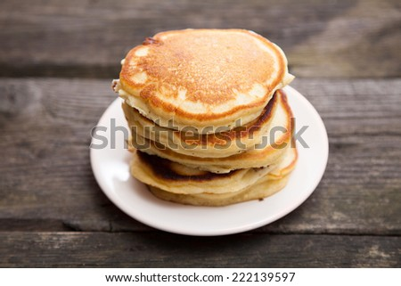 Delicious pancakes on a wooden table - stock photo