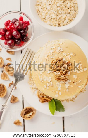 delicious pancakes on a wooden table with nuts - stock photo