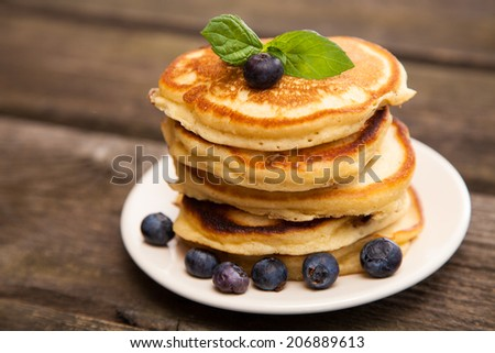 Delicious pancakes with blueberry and mint - stock photo