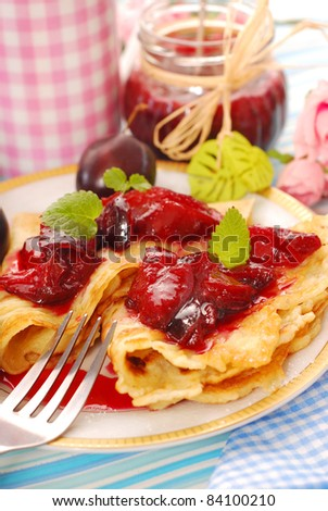 delicious pancakes with homemade fresh plum`s confiture - stock photo