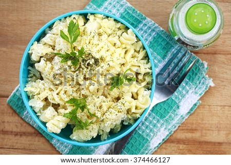 delicious pasta with cheese sauce - stock photo