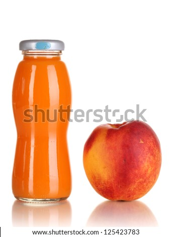 Delicious peach juice in glass bottle and peach next to it isolated on white - stock photo