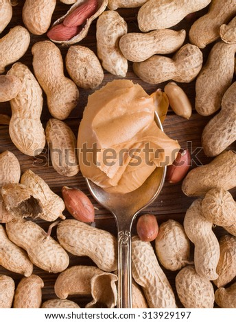 Delicious peanut butter in spoon - stock photo