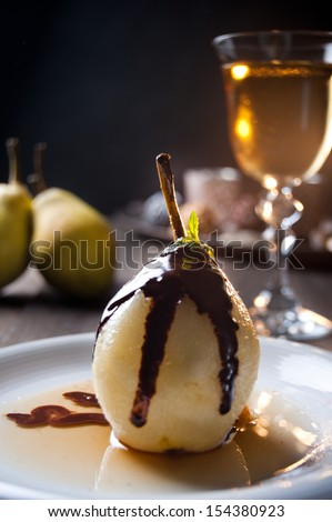 Delicious pear dessert with chocolate and amaretto liqueur - stock photo