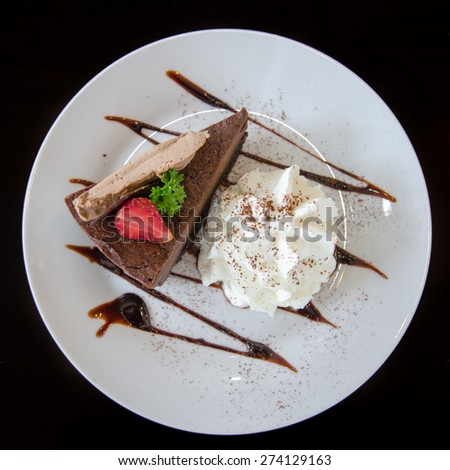 Delicious Piece of Chocolate cheesecake with strawberry - stock photo