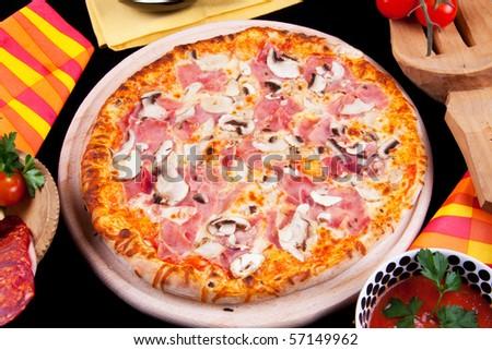 Delicious Pizza Prosciutto and Mushrooms - stock photo