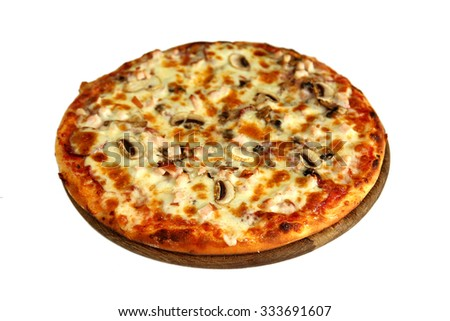 Delicious pizza with mushrooms, smoked meat on wooden stand isolated on white - stock photo