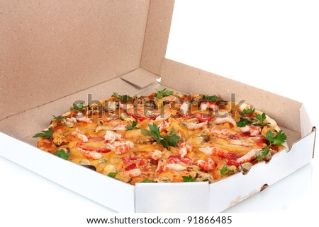 Delicious pizza with seafood in packaging isolated on white - stock photo