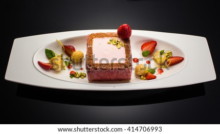Delicious plate dessert on grey gradient background - stock photo