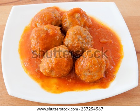 Delicious plate of meatballs with tomato sauce - stock photo