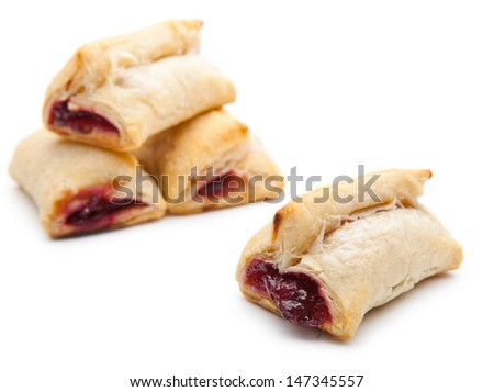 Delicious Plum puff pastry on white background - stock photo