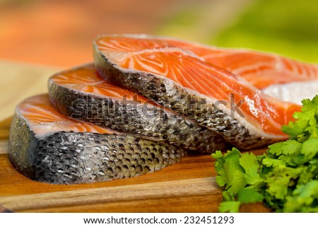 Delicious  portion of fresh salmon fillet  with aromatic herbs, spices and vegetables - stock photo