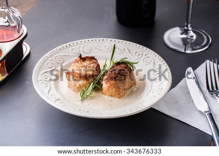 Delicious portion of healthy grilled lean medium rare beef steak cut through and served on a wooden kitchen board garnished with fresh herbs - stock photo