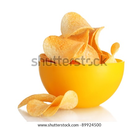 Delicious potato chips in bowl isolated on white - stock photo