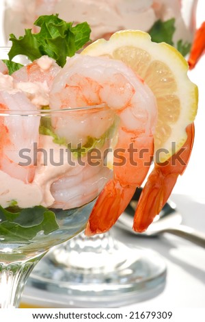 Delicious Prawn Cocktail.  Fresh jumbo shrimps, cream, lettuce leaves, lemon wedge and zesty sauce. Appetizer served in cocktail glass with whole wheat crackers. - stock photo