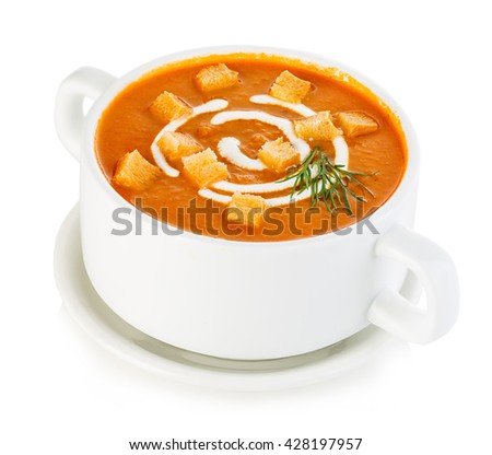 Delicious pumpkin and carrot soup with sour cream and croutons close-up isolated on a white background. - stock photo