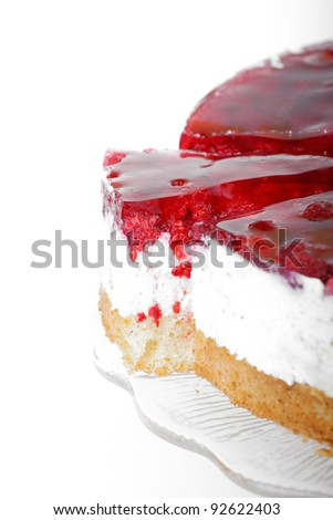 delicious raspberry layer cake with one slice ahead - stock photo