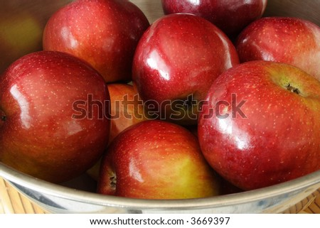 Delicious red apples in a bowl - stock photo