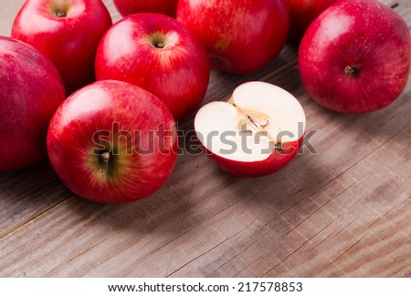 Delicious red apples on the wooden table - stock photo