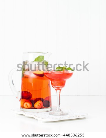 Delicious refreshing summer cocktail made with fresh cherries and peaches. - stock photo