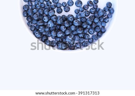 delicious ripe Blueberries in white plate on white background. Vegetarian food. Blue berries to the Perfect diet. ideal for smoothies - stock photo